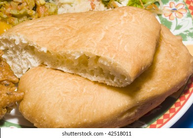 fry bake trinidad tobago native bread like jonnycake from street vendor restaurant as photographed in port of spain trinidad