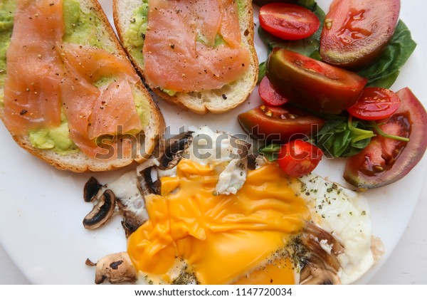 fry eggs with mushrooms, cheese, avocado and salmon