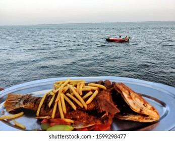 fry fish with french fry sea food with Salad sea view Sky view images