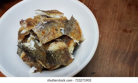 Fry fish on white dish  on wooden table , thai cuisine