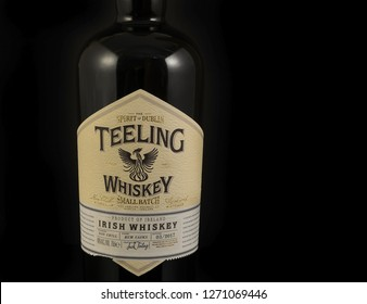FRYDEK-MISTEK, CZECH REPUBLIC - DECEMBER 23, 2018: Bottle of Irish Whiskey Teeling, Irish whiskey on black background. Unique Irish whiskey produced in small batches   - illustrative editorial
