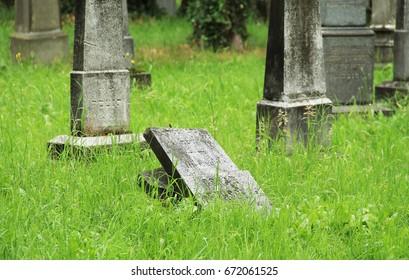 FRYDEK-MISTEK, CZECH REPUBLIC – July 2: broken old tombstone on the jewish cemetery in Frydek-Mistek, Czech Republic, July 2, 2017