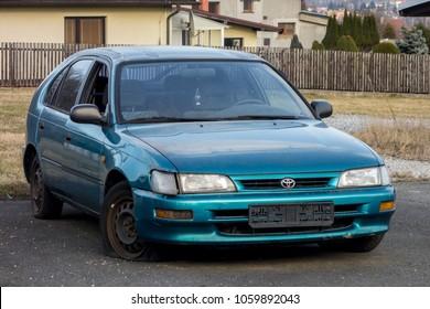 FRYDEK-MISTEK, CZECH REPUBLIC - MARCH 25, 2018: Abandoned azure blue Toyota Corolla hatchback car from 90s with a flat tire. The image was taken on March 25, 2018.