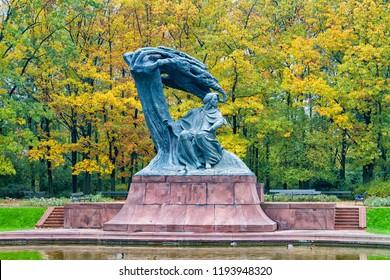 Fryderyk Chopin monument in autumn scenery of the Royal Lazienki Park in Warsaw, Poland, designed around 1904 by Waclaw Szymanowski (1859-1930).