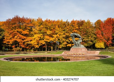Fryderyk Chopin monument and pond in autumn Royal Lazienki Park in Warsaw, Poland