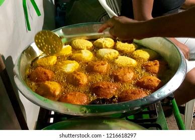 Frying Acaraje a African Brazilian food.