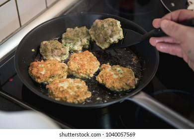 Frying Chicken burger patties in the pan
