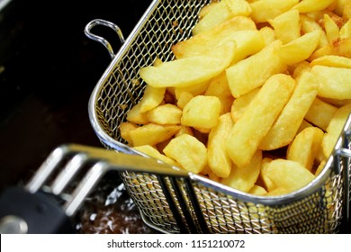frying chipped potatoes in deep fat fryer