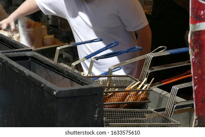 Frying corn dogs at  the 50th Annual University District Street Fair (oldest in the country),Seattle, Washington