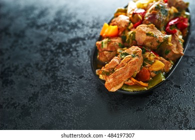 Frying pan with cut veal , close-up, Grilled beef barbecue, braised veal shank, osso buco or bucco homemade, beef stroganoff with vegetable. Healthy and tasty