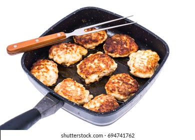 Frying pan with cutlets on white background. Studio Photo