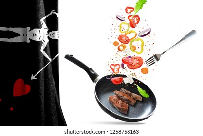 Frying pan with falling vegetables and meat, isolated objects. On the background of the flag of Blackbeard Pirate