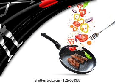Frying pan with falling vegetables and meat, isolated. On the background of the flag of Blackbeard Pirate