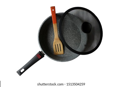 frying and pan glass lid, wooden spatula isolated on white background, top view