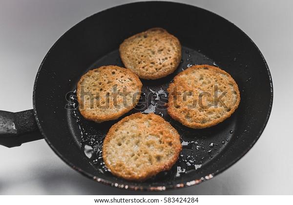 Frying pan with pancakes from potatoes, potato pancakes