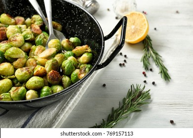 Frying pan with roasted brussel sprouts on table