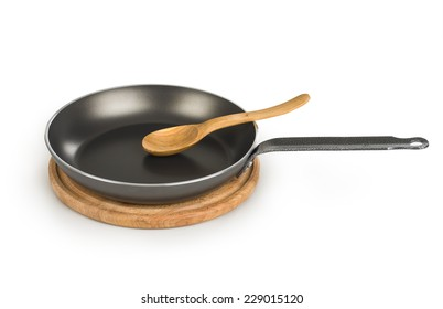 frying pan with wooden spoon isolated