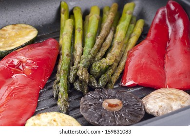 frying vegetables on pan
