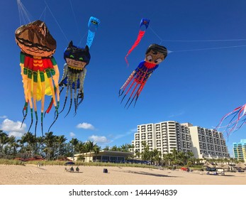 Ft. Lauderdale, FL / USA - December 30, 2018:  Kites with octopus tentacles in the likeness of superheroes Batman, Robin and Superman fly above the beach on December 29, 2018 in Ft. Lauderdale, FL.
