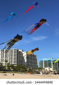 Ft. Lauderdale, FL / USA - December 30, 2018:  Kites in the likeness of superheroes Batman, Robin and Superman soar above the beach on a sunny day on December 29, 2018 in Ft. Lauderdale, FL.
