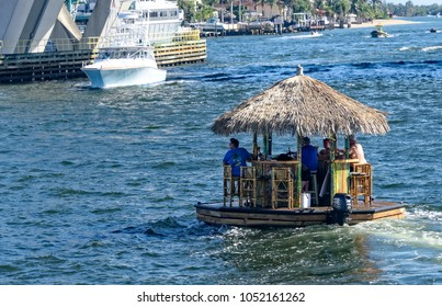 Ft. Lauderdale, Florida - February 18, 2018:  Floating titi bar with customers as it makes it's way up and down the intercoastal waterway.