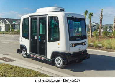 Ft. Myers, Florida / USA - December 22, 2018: EasyMile EZ10 autonomous vehicles are being tested as driverless buses.