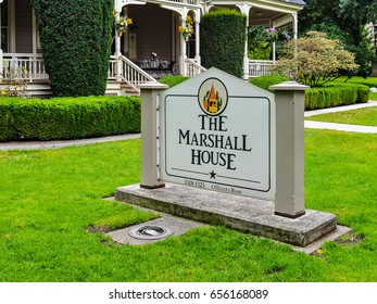 Ft. Vancouver, WA - Aug. 11, 2013: Marker in front of George Marshall House. Gen. George Marshall lived in this house when he commanded the Vancouver Barracks in the 1930s.