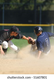 FT. WASHINGTON, PA - APRIL 23: Germantown Academy shortstop Sean Coyle tries to tag Malvern's Drew Hayes on a stolen base attempt in a rivalry  game on April 23, 2010 in Ft. Washington, PA