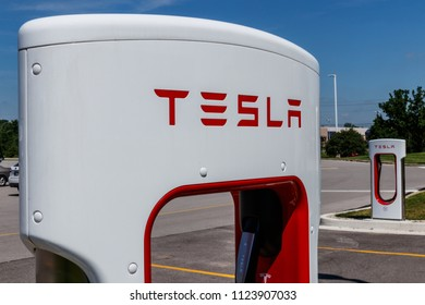 Ft. Wayne - Circa June 2018: Tesla Supercharger Station. The Supercharger offers fast recharging of the Model S and Model X electric vehicles IX