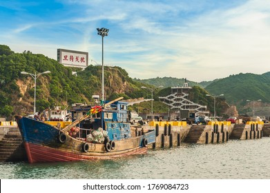 """Fuao Harbor at Nangan island, Matsu, Taiwan. translation of the chinese text is """"make a spear as pillow to wait for the daybreak"""" It means all set to start the battle"""