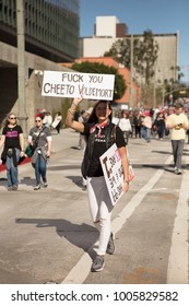 """""""Fuck you Cheeto Voldemort"""". Women's march Los Angeles, USA-January 20, 2018, showed the liberal people speaking out with signs against Donald Trump and speaks about minorities."""