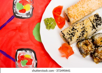 Fud art. Japanese sushi on a white plate on the tablecloth are made watercolor paint abstract image of a smiling emoticon with eyes Japanese sushi