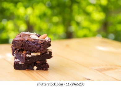 Fudge brownie on the wood table,Garden background,copy spaces