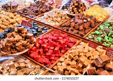 Fudge varieties in an artisanal sweets and chocolate shop.