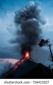 Fuego active volcano erupting at nightfall