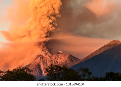 Fuego volcano erupting at dawn next to Acatenango volcano  near Antigua, Guatemala, Central America