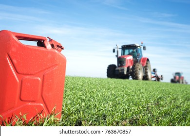 Fuel and agriculture machines. Gas can and tractor in the field. Biodiesel and petrol production.
