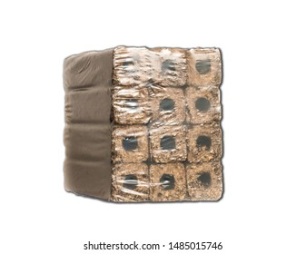 Fuel briquettes folded in rows on a white background. Wooden  briquettes are an environmentally friendly fuel source that are used to start a fire. They are made by pressing of dry sawdust.