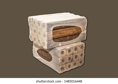 Fuel briquettes folded in rows on a brown background. Wooden  briquettes are an environmentally friendly fuel source that are used to start a fire. They are made by pressing of dry sawdust.