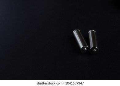Fuel cells batteries, two AA silver  on black background with copy space for text