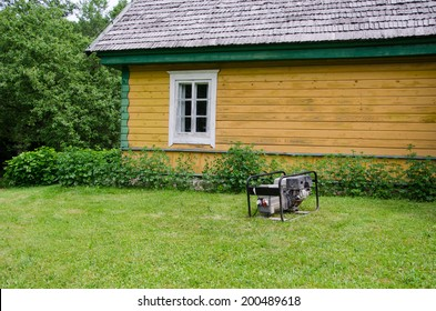 fuel diesel electricity generator work near rural house in village.