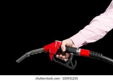 Fuel dispenser in men's hand. Isolated on black