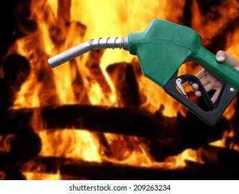 Adding fuel images stock photos vectors shutterstock fuel dispenser on fire background publicscrutiny Images