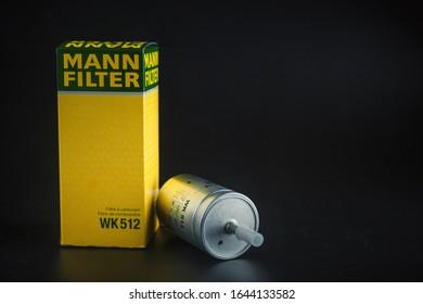 Fuel filter Mann on black background. Gasoline filter mann