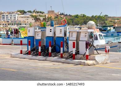 Fuel gas stations in the fishing port of the village of Marsaxlokk. Malta.