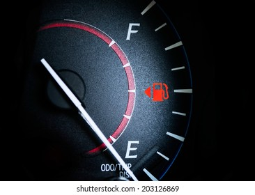 Fuel Gauge Showing Almost Empty,Time for another very expensive fuel purchase. Red warning icon light door.