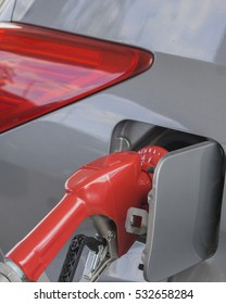 Fuel going into car/Gas Nozzle/Gasoline pumping into vehicle.