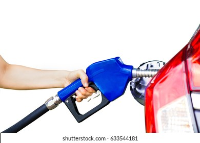 Fuel nozzle during refueling at a gas station,  dispenser pumping diesel or gasoline in car.