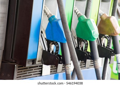 Fuel Nozzle at Gasoline station for fill benzine or diesel as energy power for vehicle