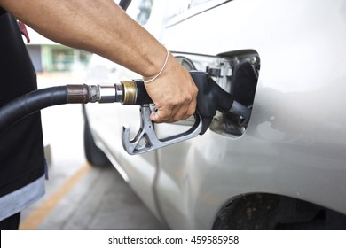 Fuel nozzle in pouring to car